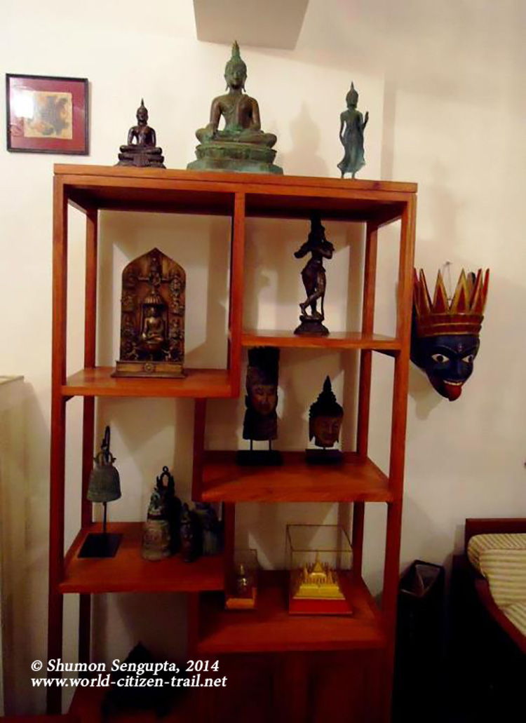 Top shelf- -Lord Buddha (standing and seated) in Bronze;  Source - Laos,