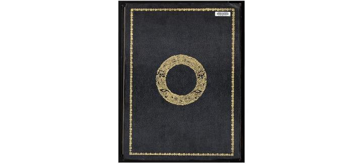 Back Cover- Decorative patterns embossed in gold on black leather. The influ