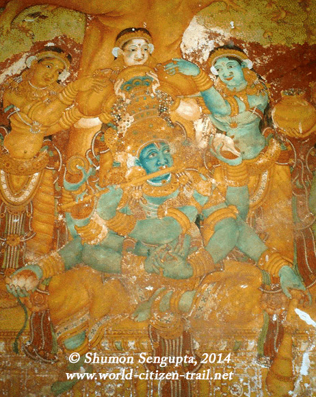 Sri Krishna being pampered by the Gopinis