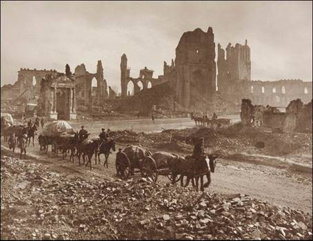 Source: http://www.flandersfieldsmusic.com/ww1-photos.html The ruins of the Cloth Hall, the Cathedral and Bishop's Palace, Ypres, Flanders
